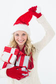 Attractive woman wearing santa hat with gifts — Stock fotografie