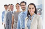 Smiling employee's in a line — Stock Photo