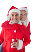Happy mature couple wearing santa hats — 图库照片