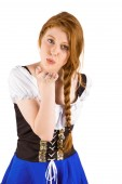 Oktoberfest girl blowing a kiss — Stock Photo