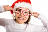 Festive little girl smiling at camera — Stock Photo