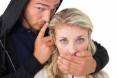Theft covering young woman's mouth — Stock Photo