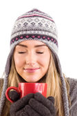 Happy blonde in winter clothes holding mug — Foto Stock