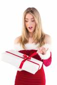 Pretty santa girl opening gift — Stock Photo