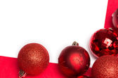 White page with red christmas baubles — Foto Stock