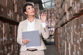 Warehouse manager checking her inventory — Stock Photo