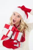 Santa woman scratching head and holding gifts — Stock Photo