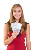 Pretty blonde showing wad of cash — Stock Photo