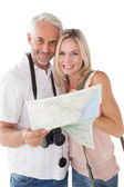 Happy mature couple looking at map — Stock Photo