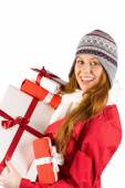 Pretty redhead in warm clothing holding gifts — Stockfoto