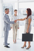 Businessman shaking co-workers hand — Stock Photo