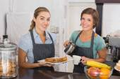 Pretty waitresses working with a smile — Stock Photo