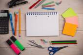 Students table with school supplies — Stockfoto