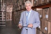 Warehouse manager smiling — Stockfoto