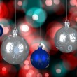Composite image of blue and silver christmas baubles — Stock Photo #56886765