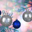 Composite image of blue and silver christmas baubles — Stock Photo #56887091