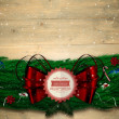Composite image of fir branch christmas decoration garland — Stock Photo #56889395