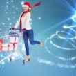 Festive blonde pushing trolley full of gifts — Stock Photo #56889585