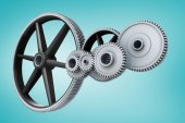 White cogs and wheels connecting — Stock Photo