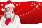 Festive blonde showing fan of dollars — Stock Photo