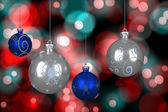 Composite image of blue and silver christmas baubles — Stok fotoğraf