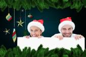 Festive young couple smiling at camera — Stock Photo