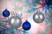 Composite image of blue and silver christmas baubles — ストック写真