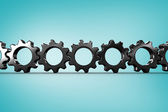 Metal cogs and wheels connecting — Stock Photo