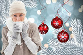Composite image of woman in warm clothing holding mugs — Foto Stock