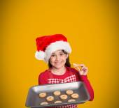 Composite image of festive little girl offering cookies — Stock Photo