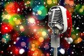 Microphone with Santa hat — Stok fotoğraf