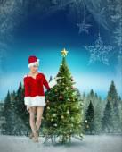 Pretty santa girl presenting with hand — Stock Photo