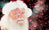 Composite image of santa claus winking — Stock Photo