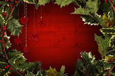 Composite image of holly and christmas branches forming frame — Stock Photo