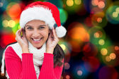 Composite image of festive brunette — Stock Photo