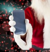 Santa Claus showing smartphone — Stock Photo