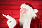 Złożony obraz dmuchanie santa claus — Zdjęcie stockowe