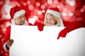 Composite image of festive couple — Stock Photo