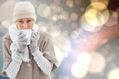 Woman in warm clothing holding mugs — Foto de Stock