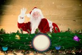 Composite image of santa claus waving — Stock Photo