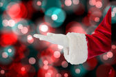 Santa Claus presenting with hand — Stock Photo