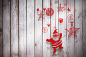 Composite image of hanging red christmas decorations — Zdjęcie stockowe
