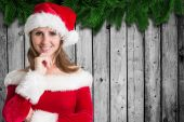 Composite image of pretty girl in santa outfit — Stock Photo