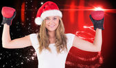 Festive blonde with boxing gloves — Stock Photo