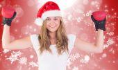 Immagine composita della bionda festivo con i guanti di inscatolamento — Foto Stock