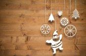 Composite image of hanging christmas decorations — Foto de Stock