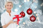 Composite image of mature woman holding gift — Foto de Stock
