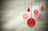Composite image of hanging red christmas decorations — ストック写真