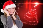 Composite image of festive blonde smiling at camera — Stockfoto