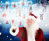 Santa pointing to christmas people collage — Photo
